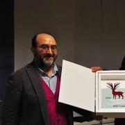 Il premio Empty Cages allo scrittore Will Tuttle, consegnato dall'Editore Sonda e dallo Chef Leemann